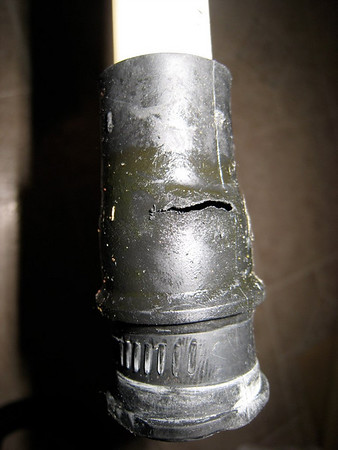 Water-Worn Rubber Fitting on the Old Upper Spray Arm Water Feed Tube